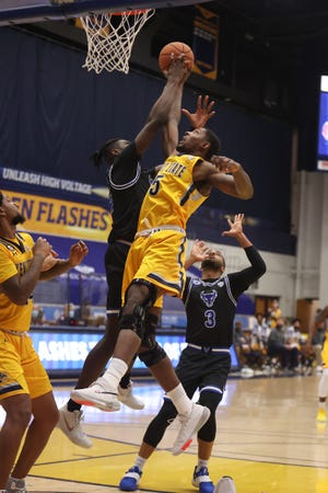 Kent State senior forward Danny Pippen goes up for a shot while Buffalo junior Josh Mballa defends during the first game of the current season between the two teams on Jan. 19 in Kent, won by the Golden Flashes. The rematch will take place Friday night in Buffalo.