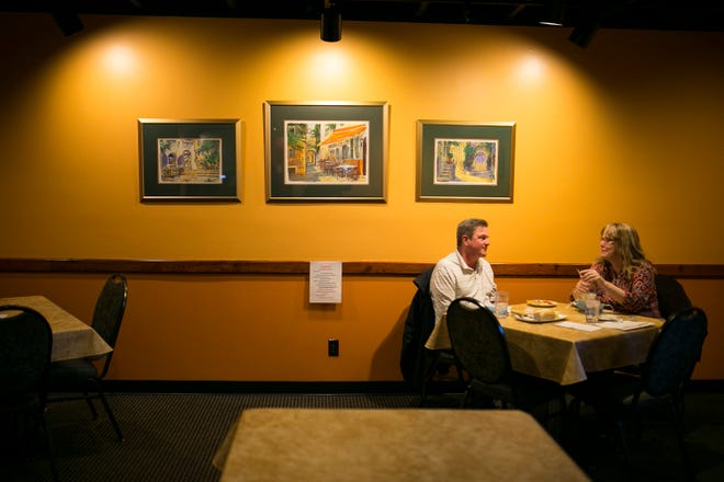 Diners Susan and Hank Gill of Loves Park eat inside at Nunzio's Restaurant on Wednesday, Jan. 20, 2021, in Loves Park. Tables are spaced out for indoor dining.