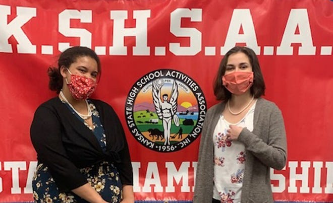 Tiana Marion, left, and Maya Daily pose for a photograpah by the KSHSAA Banner after taking first place in the Class 5A  state debate competition.