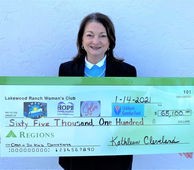 Eileen Buzzard, Lakewood Ranch Women's Club philanthropy co-chair, with the club's donation to its four adopted charities.
