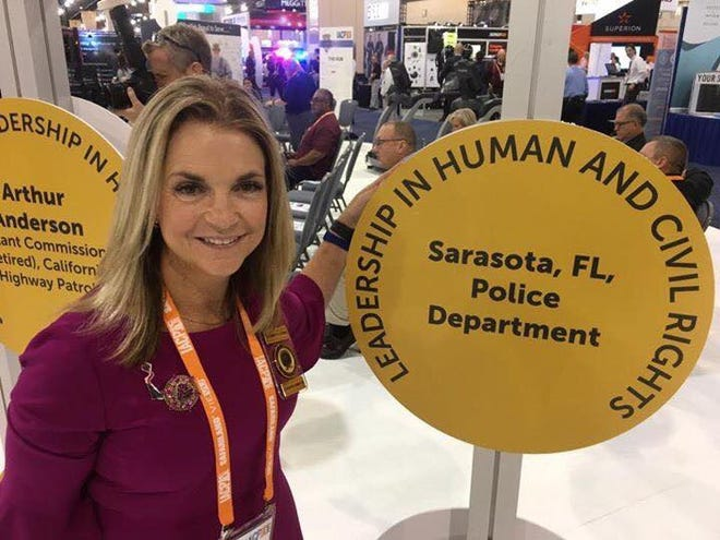 At a banquet  in Philadelphia in 2017, Sarasota Police Chief Bernadette DiPino accepted an award honoring her department for its work with the homeless.