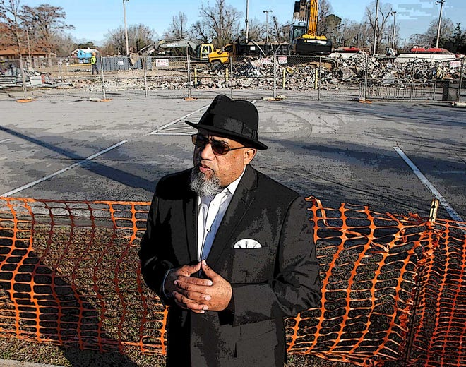 Leander Morgan Jr. speaks about the importance of the Stanley White Recreation Center to the community as heavy equipment removes demolition debris from the site in the historic Duffyfield community of New Bern.