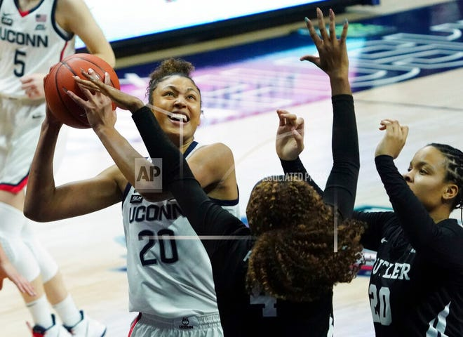 UConn forward Olivia Nelson-Ododa (20) shoots against Butler in the first half of an NCAA college basketball game Tuesday, Jan. 19, 2021, in Storrs, Conn.