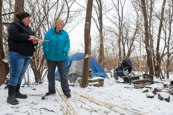 Wendy Martindale Kenney, on the right, shared information at her campsite last January with Valeo outreach case manager Kelly Kendall as she helped take a count of Topeka's homeless population.
