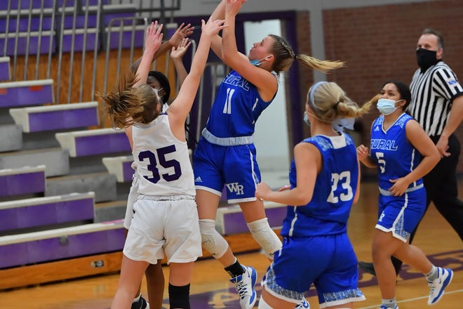 Washburn Rural's Emma Krueger (11) goes in for a contested layup during Tuesday's game at Topeka West. Krueger scored 11 points in the first quarter and finished with 17 as the Junior Blues rolled 70-25.