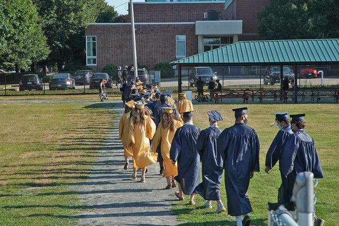 The Coyle & Cassidy class of 2020 leaves the football field at Hopewell Park at the end of the final graduation. on Aug. 6, 2020.