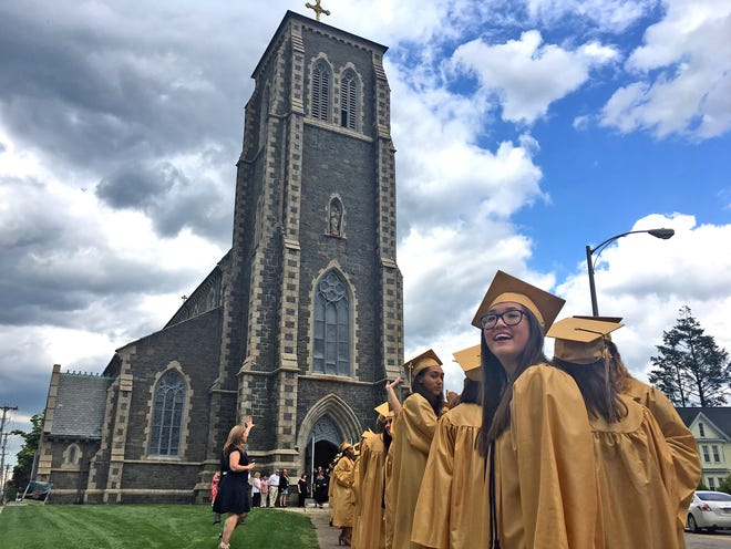 Kristal Yee is all smiles as she waits in line to go into St. Mary's Church in Taunton for Coyle & Cassidy's 2017 graduation ceremony.