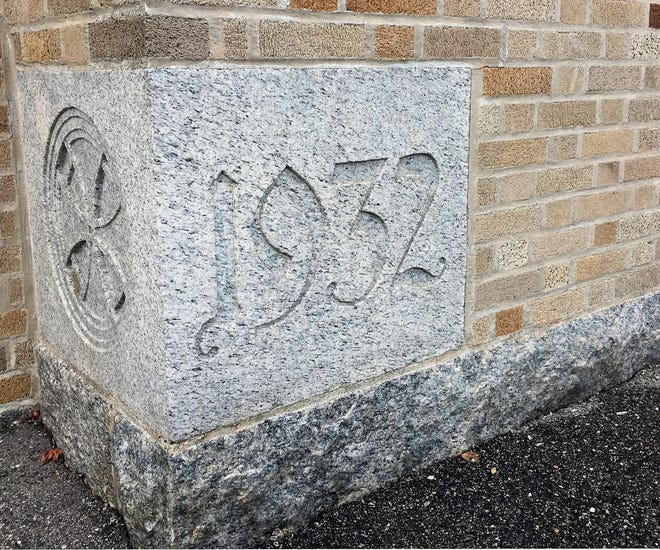 This carved block in a front corner of the former Monsignor James Coyle High School at 61 Summer St., Taunton, seen here in 2018, indicates the year the school building was constructed.