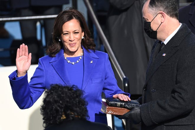 Kamala Harris is sworn in as vice president by Supreme Court Justice Sonia Sotomayor, as her husband Doug Emhoff holds the Bible during the 59th Presidential Inauguration at the U.S. Capitol in Washington, Wednesday, Jan. 20, 2021