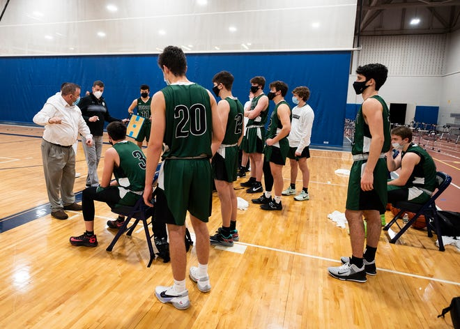Wachusett Regional coach Tom Gibbons, left, addresses his team during a timeout in a game last month against Shrewsbury.