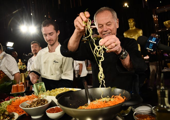 "Chef Wolfgang Puck right, and his son Byron make a pasta dish at the Governors Ball Press Preview for the 92nd Academy Awards in Los Angeles on Jan. 31, 2020. A new four-part documentary series, ""The Event,"" shows the intense planning and details that go into high-profile catering. The series premiered on HBO Max on Jan. 14."