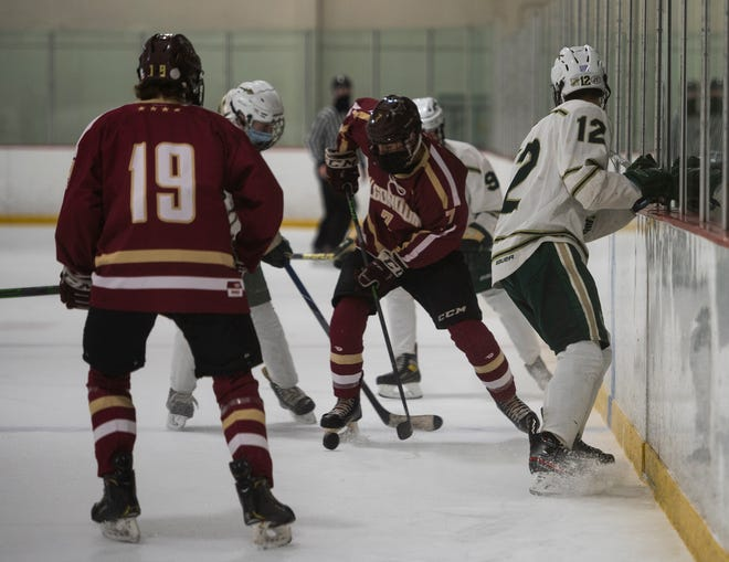 Algonquin's Henry Antino controls the puck during the game against Nashoba earlier this season.
