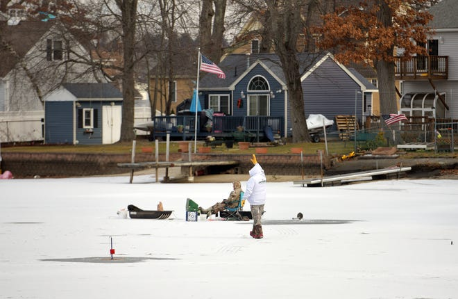 WORCESTER - Two men from Cape Cod traveled all the way to Indian Lake Wednesday to fish. The men used an auger to cut through about 6 inches of ice.