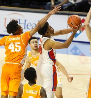 Florida guard Noah Locke goes to the basket to score Tuesday against Tennessee at Exactech Arena.