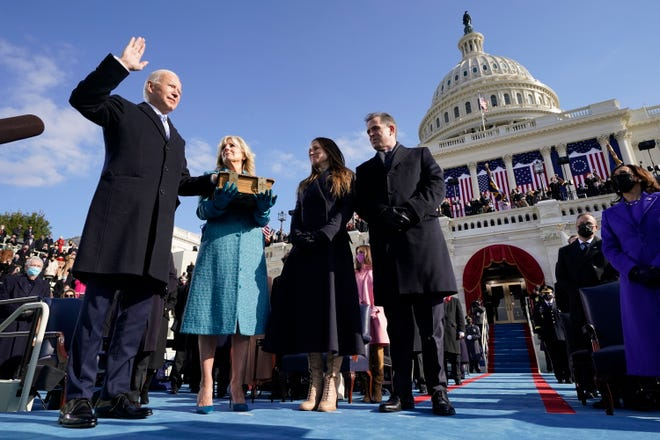 Joe Biden is sworn in as the 46th president of the United States by Chief Justice John Roberts as Jill Biden holds the Bible during the 59th Presidential Inauguration at the U.S. Capitol in Washington on Jan. 20.