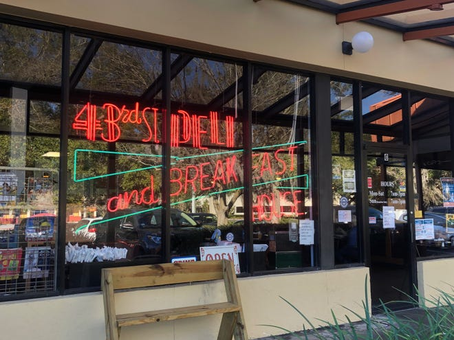 The window at 43rd Street Deli, 4401 NW 25th Place, in Gainesville, is seen Tuesday. The restaurant, which has operated in the Millhopper area for 38 years, will move across the street to a larger building in March. [Emily Mavrakis/The Gainesville Sun]