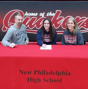 New Philadelphia's Mackenze Baker has signed at Malone University to golf and continue her education. Baker was a part of the 2019 team that advanced to the Division I state championship tournament. Baker is pictured with her parents Adam and Heather Shapaka,