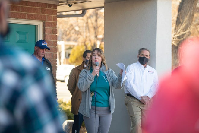Tamra Axworthy, CEO of A Caring Pregnancy Center, speaks at the ribbon cutting event for the new Women's Medical Clinic at 510 Colorado Ave. on Wednesday Jan. 20.