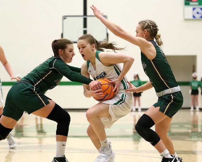 Alma's Loryn Kelley, left, and Halyn Carmack pressure Van Buren's Avery Shelly at the top of the key in the first quarter, Wednesday, Jan. 20, at Van Buren.
