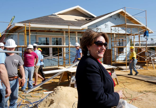 Nick and Terry Saban presented a $100,000 check to Habitat for Humanity Friday, Feb. 19, 2016, to pay for a new Habitat home at 19 Juanita Drive commemorating the 16th national championship. Terry Saban is seen in front of the home, which was still under construction. [Staff file photo]