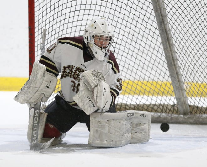 New Albany's Max Dupler makes a save against St. Charles earlier this season. Dupler and Brandon Beesley have combined to form a strong goalie tandem for the Eagles. Dupler also has seen time at defenseman.