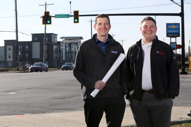 Ryan Andrews (left), Whitehall's consulting city engineer with EMH&T, and Zach Woodruff, Whitehall's director of development and public service, are shown Jan. 19 at the intersection of Hamilton Road and East Broad Street in Whitehall. The Ohio Public Works Commission recently approved the city's grant-funding request for improvements at the intersection.