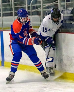Orange's Austin Knupp gets physical with Liberty's Isaac Moe during a game earlier this season. Knupp had a team-leading 23 goals and 23 assists through 17 games as the Pioneers rolled to a 13-3-0-1 start.