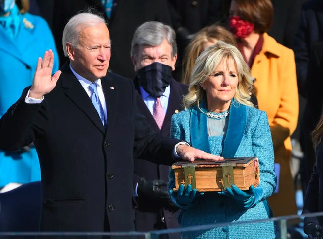 Joe Biden takes the oath of office on the Capitol steps.