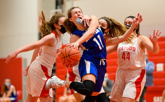 Kristina Yebba of Danvers gets a had in the face as she attempts a layup during a game versus Saugus at Saugus High School on Tuesday, Jan. 19, 2021.