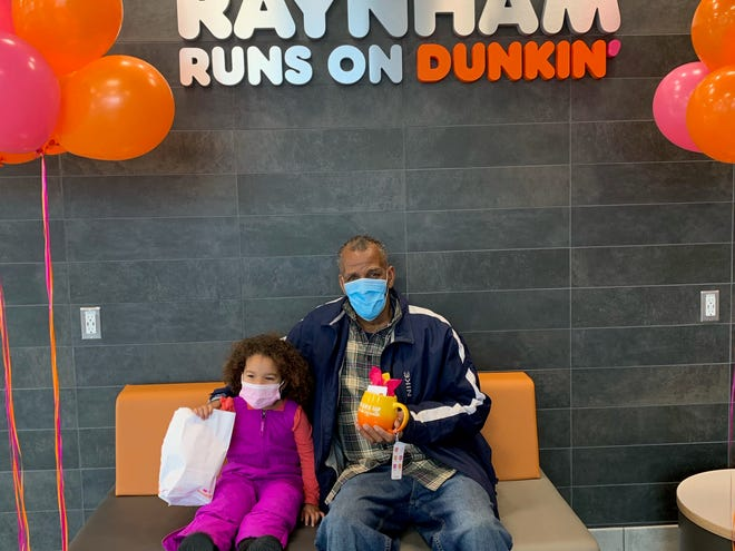 Deryll Walker recently won free coffee for a year at Raynham Dunkin' location, 406 New State Highway. Pictured are Walker and his granddaughter.