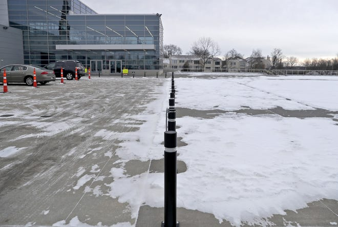 A line of bollards separates the turnaround area from event space at the Fox Cities Exhibition Center in Appleton. The center is serving as a COVID-19 testing site.
