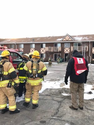 Firefighters and American Red Cross  workers responded Wednesday, Jan. 20 to a fire at Jefferson Park Apartments on Third Street in Menasha.