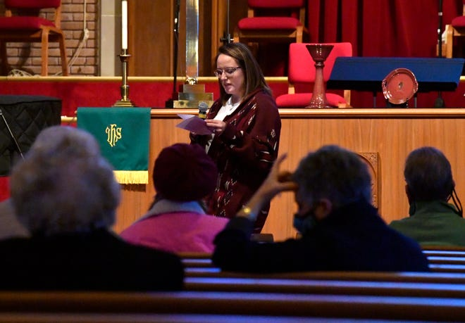 "Kimber Morgan leads a group of about a dozen in a prayer Wednesday morning at Aldersgate United Methodist Church. The short ceremony was held at the same time as Joe Biden was being sworn in as the 46th president of the United States. ""We decided it was really important to pray for our nation and to remind everybody that ultimately we are children of God,"" Morgan said. ""That is where hope lies beyond the division right now between political parties and all of the unrest."""