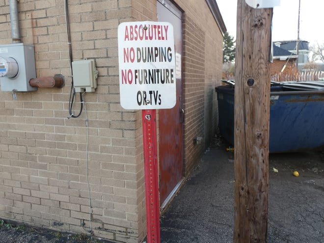 A sign behind the Bucyrus Salvation Army is frequently ignored by people dumping unwanted items near the donation bins.