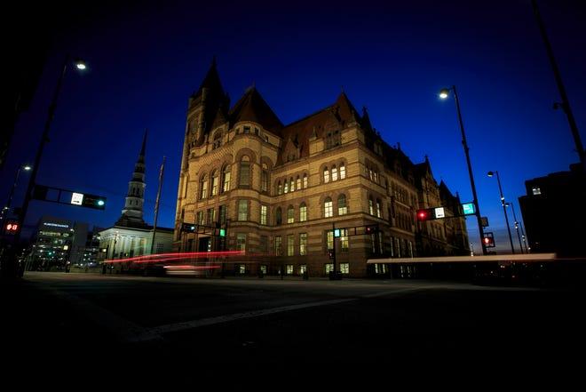 An illuminated Cincinnati City Hall as seen downtown on Tuesday, Jan. 19, 2021.