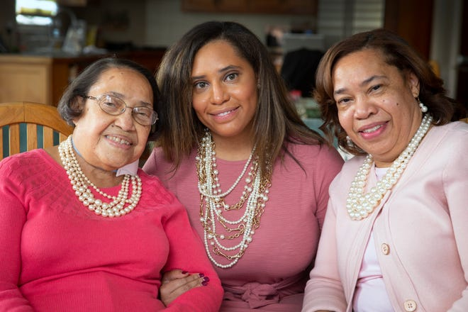 Beatrice Melvin, 91, her granddaughter, Erica White, and daughter Bonita White, gathered together to watch the swearing of Joe Biden as the 46th President and Kamala Harris as Vice President Wednesday, Jan. 20, 2021. All three, along with Harris, are part of the sisterhood of Alpha Kappa Alpha, (AKA), the oldest Black sorority in the United States. The color pink and the wearing of pearls is part of the sisterhood. Harris also was wearing pearls as she was sworn in as Vice President. Melvin said she never thought she would see a woman of color ascend to the vice presidency.