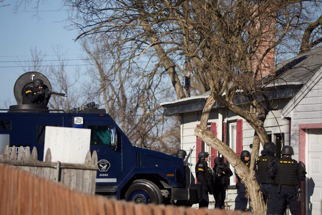 The Cincinnati police SWAT team at a home Wednesday January 20,2021 in Mount Washington after a report of a barricaded man. The SWAT team were called to the 2300 block of Salvador Street around 2 p.m.