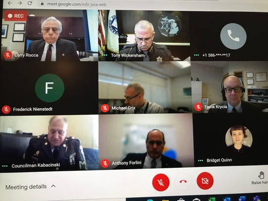 Warren City Councilman Eddie Kabacinski (bottom left) appears in a military police uniform during a Macomb County Election Commission meeting Jan. 20, 2021 regarding proposed recall petition language filed against him.