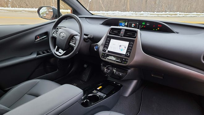The innovative interior of the Toyota Prius includes both screens located in the center console - and a gear shifter high on the dash to open console space.