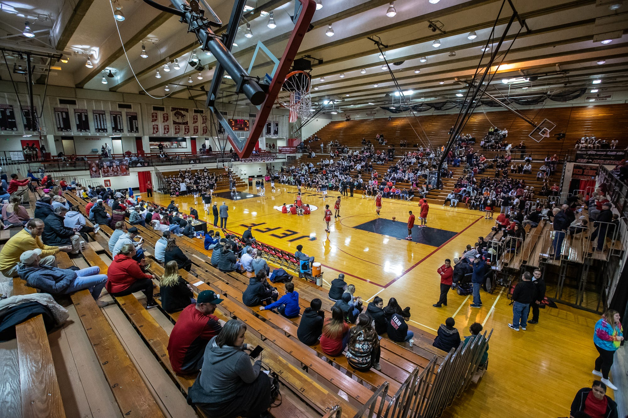 Fans watch as the Lafayette Jefferson Bronchos warm up for their game against the Richmond Red Devils at Jefferson High School's Marion Crawley Athletic Center on Friday, Feb. 21, 2020.