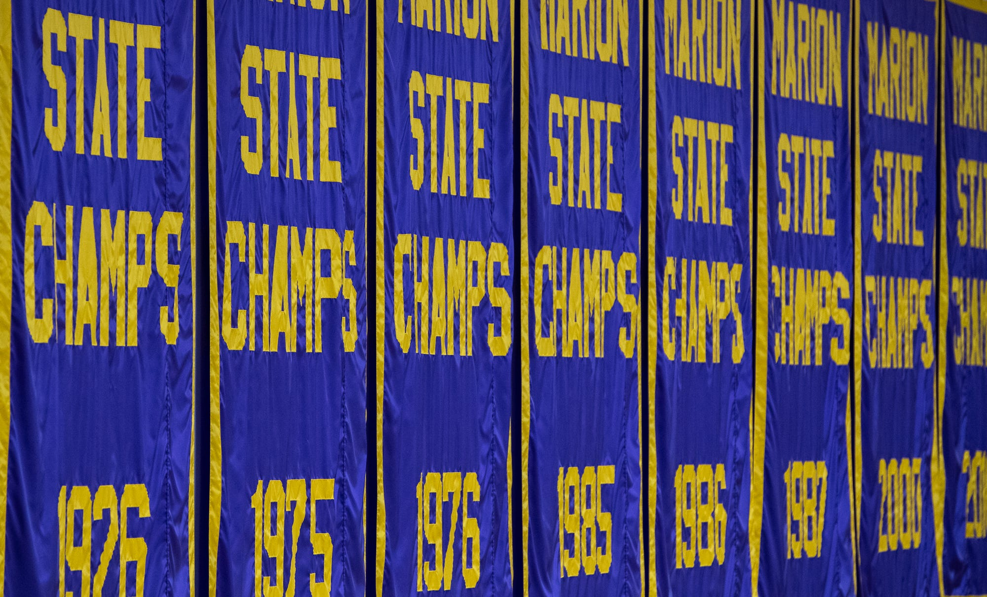 Eight state champion banners fly inside Marion High School's Bill Green Arena on Friday, Feb. 28, 2020.