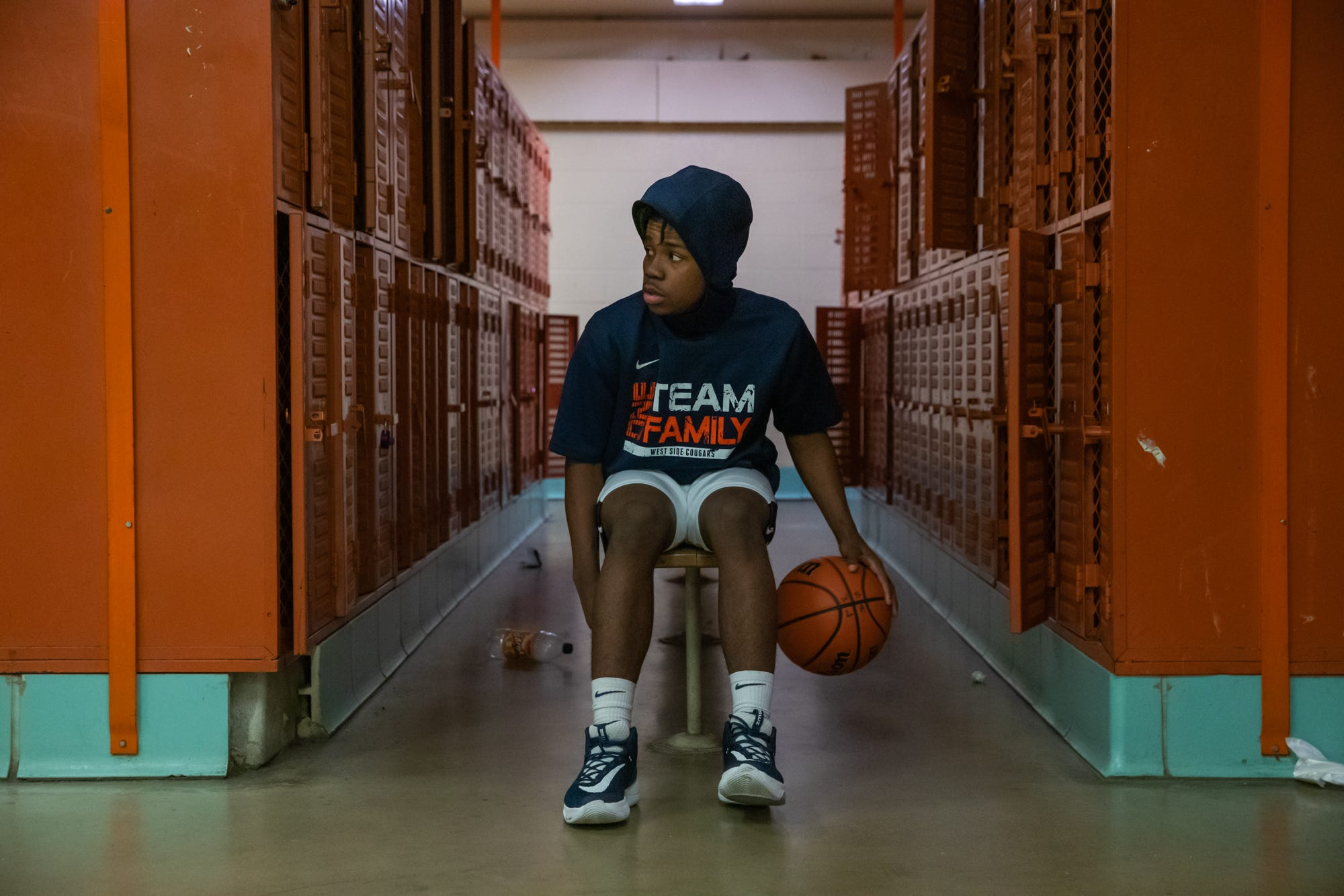 West Side Cougars' Israel Hines dribbles in the locker room before the varsity game against the East Chicago Central Cardinals at West Side Leadership Academy in Gary, Ind., on Thursday, Jan. 30, 2020.