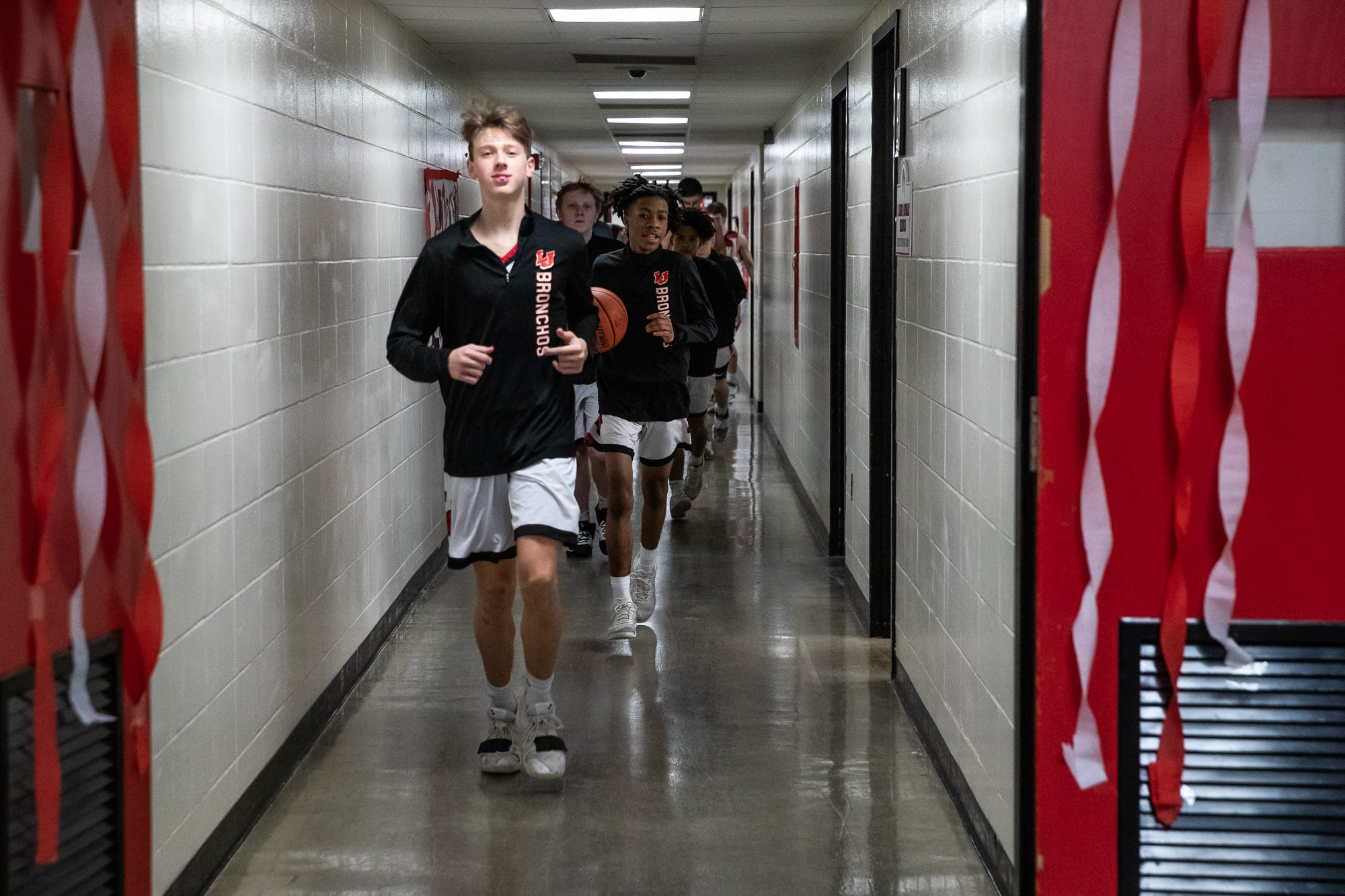 The Lafayette Jefferson Bronchos' boys basketball team heads onto the court after halftime at Jefferson High School's Marion Crawley Athletic Center on Friday, Feb. 21, 2020.
