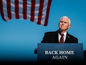 Former Vice President Mike Pence and his family join him as he gives remarks to a small crowd on Wednesday, Jan. 20, 2021 at Columbus Municipal Airport in Columbus, Ind.