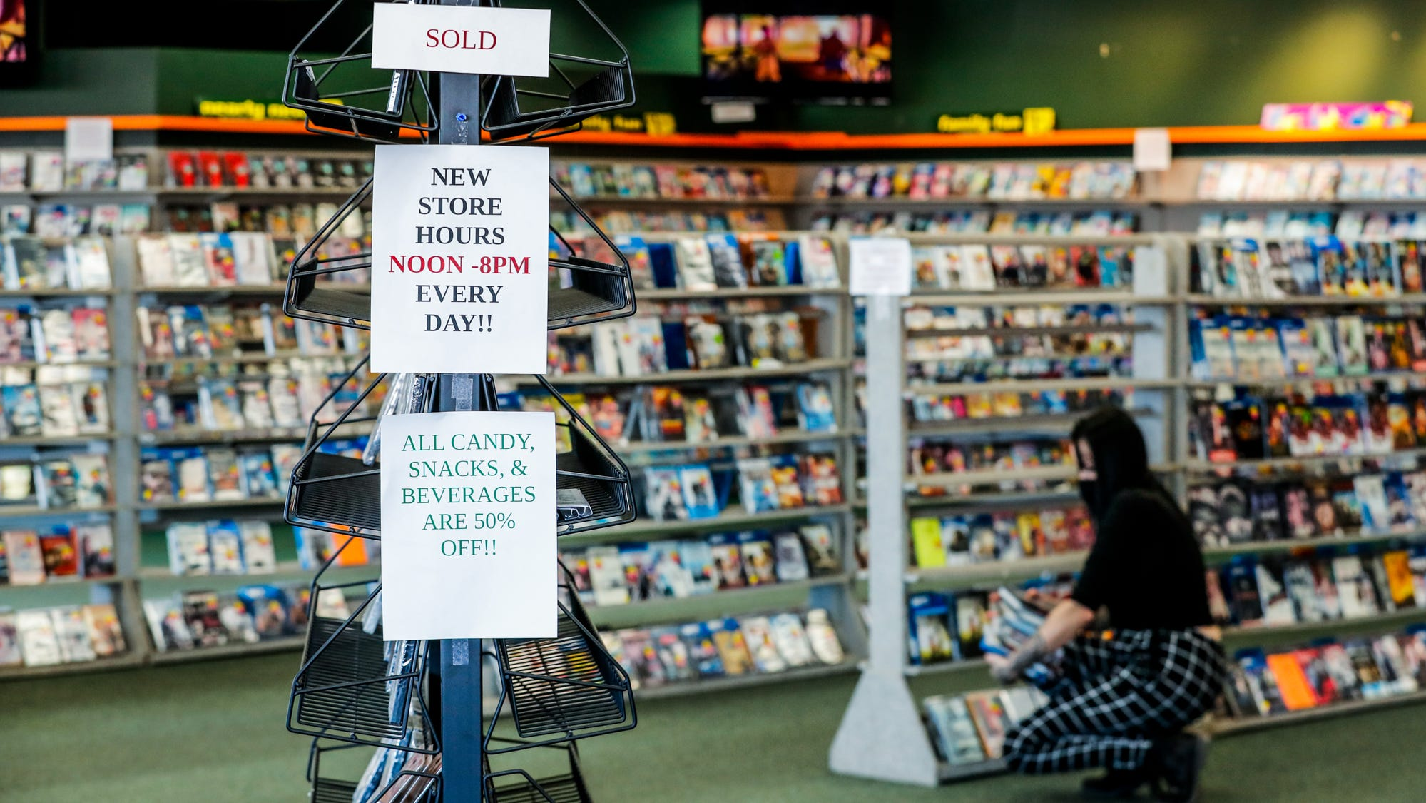 Store fixtures and movies are for sale during the store closing at Family Video, 322 S. Lebanon St., Lebanon, Ind., Wednesday, Jan. 19, 2021.