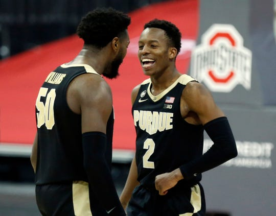 Purdue guard Eric Hunter, right, and teammate forward Trevion Williams celebrate an NCAA college basketball game win over Ohio State in Columbus, Ohio, Tuesday, Jan. 19, 2021.