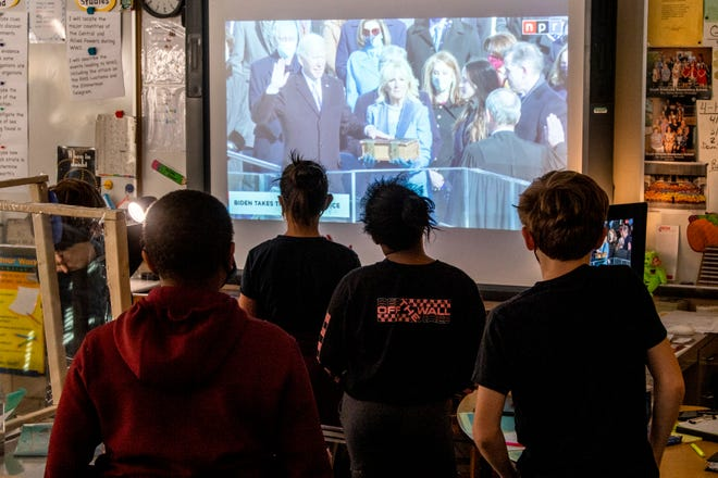 Fifth-graders in Knoxville, Tennessee, watch as President Joe Biden is sworn in on Jan. 20.