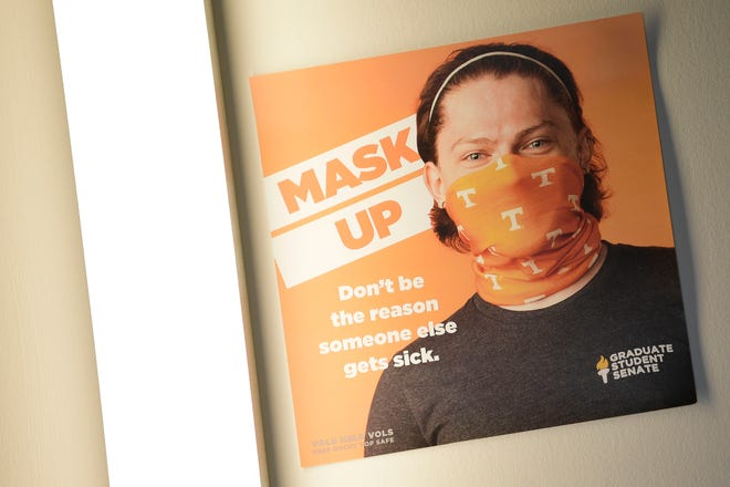 A sign in the student union asks visitors to wear face masks on the first day of the spring semester at the University of Tennessee in Knoxville, Tenn. on Wednesday, Jan. 20, 2021. The university has ruled that staff and students will be required to wear masks in some indoor spaces for the fall semester.