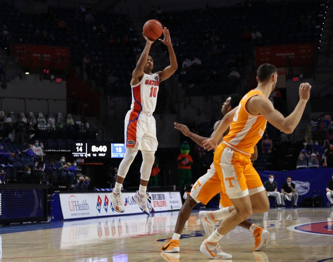 Florida guard Noah Locke shoots during Tuesday's game against Tennessee at Exactech Arena.