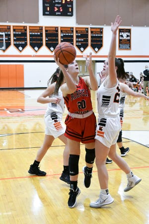 Fairfield Union's Hannah Rauch shoots a lay up Tuesday night at Amanda Clearcreek. The visiting Falcons beat the Aces 67-29.